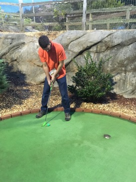Jake Playing Mini Golf